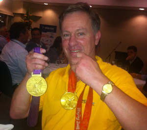 Greg holding Malcolm's Gold Medals from Beijing and London